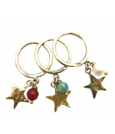 Set of three Majo rings with star pendants and hard stones
